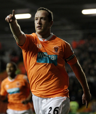 BLACKPOOL, ENGLAND - NOVEMBER 01:  Charlie Adam of Blackpool celebrates scoring the opening goal from a penalty during the Barclays Premier League match between Blackpool and West Bromwich Albion at Bloomfield Road on November 1, 2010 in Blackpool, Englan