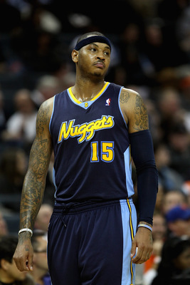CHARLOTTE, NC - DECEMBER 07:  Carmelo Anthony #15 of the Denver Nuggets watches on against the Charlotte Bobcats during their game at Time Warner Cable Arena on December 7, 2010 in Charlotte, North Carolina.  NOTE TO USER: User expressly acknowledges and