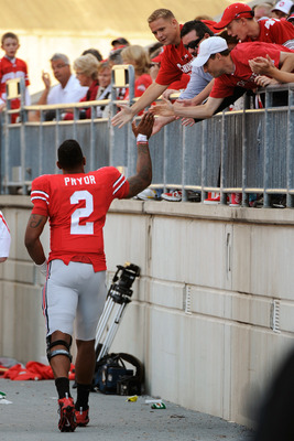 COLUMBUS, OH - SEPTEMBER 25:  Terrelle Pryor #2 of the Ohio State Buckeyes high fives fans as he leaves the field during the game against the Eastern Michigan Eagles at Ohio Stadium on September 25, 2010 in Columbus, Ohio. Pryor threw four touchdown passe