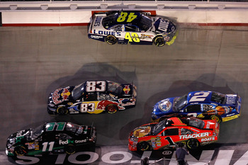 BRISTOL, TN - AUGUST 21:  Jimmie Johnson, driver of the #48 Lowe's Chevrolet, hits the wall in turn 1 during the NASCAR Sprint Cup Series IRWIN Tools Night Race at Bristol Motor Speedway on August 21, 2010 in Bristol, Tennessee.  (Photo by Todd Warshaw/Ge