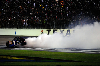 FORT WORTH, TX - NOVEMBER 07:  Denny Hamlin, driver of the #11 FedEx Office Toyota, celebrates with a burn out after winning the NASCAR Sprint Cup Series AAA Texas 500 at Texas Motor Speedway on November 7, 2010 in Fort Worth, Texas.  (Photo by Robert Lab