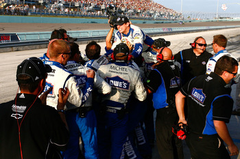 HOMESTEAD, FL - NOVEMBER 21:  Crew members for Jimmie Johnson, driver of the #48 Lowe's Chevrolet, celebrate after finishing in second place in the Ford 400 to clinch a fifth consecutive NASCAR Sprint Cup championship at Homestead-Miami Speedway on Novemb