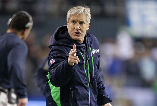 SEATTLE, WA - JANUARY 02:  Head coach Pete Carroll of the Seattle Seahawks stands on the field during their game against the St. Louis Rams at Qwest Field on January 2, 2011 in Seattle, Washington.  (Photo by Otto Greule Jr/Getty Images)