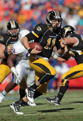 KANSAS CITY, MO - NOVEMBER 27:  Quarterback Blaine Gabbert #11 of the Missouri Tigers carries the ball during the game against the Kansas Jayhawks on November 27, 2010 at Arrowhead Stadium in Kansas City, Missouri.  (Photo by Jamie Squire/Getty Images)
