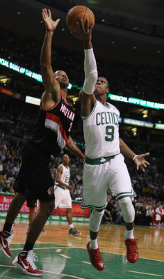 BOSTON - DECEMBER 01:  Rajon Rondo #9 of the Boston Celtics heads for the basket as Marcus Camby #23 of the Portland Trailblazers defends on December 1, 2010 at the TD Garden in Boston, Massachusetts.  NOTE TO USER: User expressly acknowledges and agrees