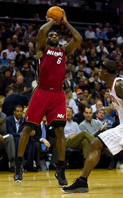 CHARLOTTE, NC - JANUARY 03: LeBron James #6 of the Miami Heat takes a jump shot over Stephen Jackson #1 of the Charlotte Bobcats at Time Warner Cable Arena on January 3, 2011 in Charlotte, North Carolina.  The Heat defeated the Bobcats 96-82.  (Photo by B