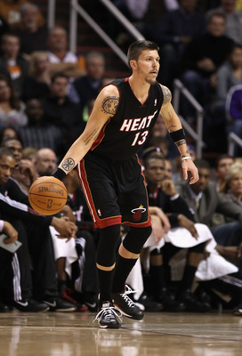 PHOENIX - DECEMBER 23:  Mike Miller #13 of the Miami Heat handles the ball during the NBA game against the Phoenix Suns at US Airways Center on December 23, 2010 in Phoenix, Arizona. NOTE TO USER: User expressly acknowledges and agrees that, by downloadin