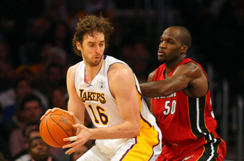LOS ANGELES, CA - DECEMBER 25: Pau Gasol #16 of the Los Angeles Lakers posts up Joel Anthony #50 of the Miami Heat during the NBA game at Staples Center on December 25, 2010 in Los Angeles, California. The Heat defeated the Lakers 96-80. (Photo by Victor