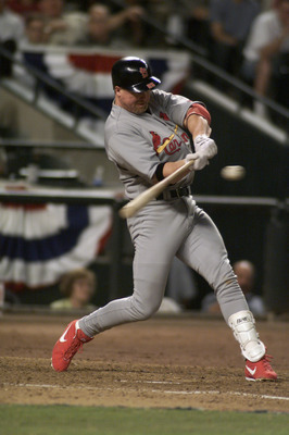 9 Oct 2001:  Mark McGwire #25 of the St. Louis Cardinals swings at a pitch during game one of the National League West Divisional Series against the Arizona Diamondbacks at Bank One Ballpark in Phoenix, Arizona. The Diamondbacks win 1-0 over the Cardinals