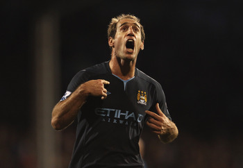 LONDON, ENGLAND - NOVEMBER 21:  Pablo Zabaleta of Manchester City celebrates scoring his teams second goal during the Barclays Premier League match between Fulham and Manchester City at Craven Cottage on November 21, 2010 in London, England.  (Photo by Sc