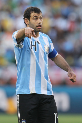 CAPE TOWN, SOUTH AFRICA - JULY 03: Javier Mascherano captain of Argentina, directs his team mates during the 2010 FIFA World Cup South Africa Quarter Final match between Argentina and Germany at Green Point Stadium on July 3, 2010 in Cape Town, South Afri
