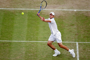 LONDON, ENGLAND - JUNE 25:  Andy Roddick of USA in action during his match against Philipp Kohlschreiber of Germany on Day Five of the Wimbledon Lawn Tennis Championships at the All England Lawn Tennis and Croquet Club on June 25, 2010 in London, England.