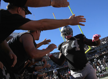 OAKLAND, CA - OCTOBER 10:  Bruce Campbell #74 of the Oakland Raiders high fives fans before their game against the San Diego Chargers at Oakland-Alameda County Coliseum on October 10, 2010 in Oakland, California.  (Photo by Ezra Shaw/Getty Images)