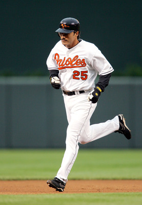 BALTIMORE, MD - MAY 25:  Rafael Palmiero #25 of the Baltimore Orioles rounds the bases after hitting a 2-run home run during the second inning of the game against the Seattle Mariners on May 25, 2005 at Camden Yards in Baltimore, Maryland.  (Photo By Jami