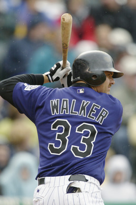 DENVER - APRIL 5:  Right fielder Larry Walker #33 of the Colorado Rockies waits for the pitch during the game against the Arizona Diamondbacks at Coors Field on April 5, 2003 in Denver, Colorado.  The Rockies defeated the Diamondbacks 4-3.  (Photo by Bria
