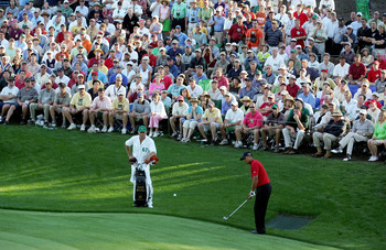 AUGUSTA, GA - APRIL 10:  Tiger Woods chips a shot to the 16th green for birdie as his caddie, Steve Williams, looks on during the final round of The Masters at the Augusta National Golf Club on April 10, 2005 in Augusta, Georgia.  (Photo by Harry How/Gett