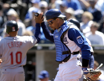 KANSAS CITY, MO - APRIL 8:  Benito Santiago #30 of the Kansas City Royals looks down at the ground as Coco Crisp #10 of the Cleveland Indians heads to the dugout after he scored on a Tim Laker hit in the second inning April 8, 2004 at Kauffman Stadium in