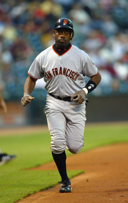 HOUSTON, TX - SEPTEMBER 22:  Marquis Grissom #9 of the San Francisco Giants circles the bases after hitting a home run in the first inning of the game against the Houston Astros on September 22, 2003  at Minute Maid Park in Houston, Texas.  The Giants won