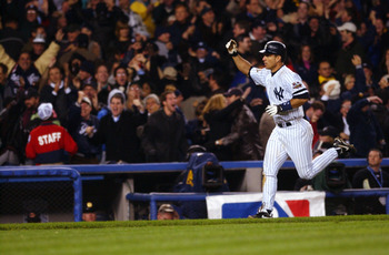31 Oct 2001:  Tino Martinez #24 of the New York Yankees circles the bases after hitting a two run home run in the 9th inning to tie the Arizona Diamondbacks during game four of the Major League Baseball World Series at Yankee Stadium in New York, New York