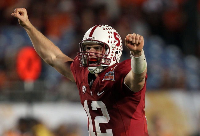 MIAMI, FL - JANUARY 03: Andrew Luck #12 of the Stanford Cardinal celebrates after he threw a 38-yard touchdown pass in the fourth quarter against the Virginia Tech Hokies during the 2011 Discover Orange Bowl at Sun Life Stadium on January 3, 2011 in Miami