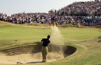 SANDWICH, ENGLAND - JULY 19: Tiger Woods of the USA plays out of the bunker on the sixth hole during the third round of The Open Championship on July 19, 2003 at the Royal St George's course in Sandwich, England. (Photo by Harry How/Getty Images)