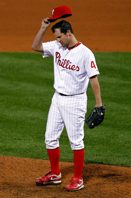 PHILADELPHIA - OCTOBER 23:  Roy Oswalt #44 of the Philadelphia Phillies adjusts his hat while playing against the San Francisco Giants in Game Six of the NLCS during the 2010 MLB Playoffs at Citizens Bank Park on October 23, 2010 in Philadelphia, Pennsylv
