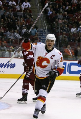 GLENDALE, AZ - MARCH 01:  Jarome Iginla #12 of the Calgary Flames celebrates after scoring his second goal of the NHL game against the Phoenix Coyotes at Jobing.com Arena on March 1, 2008 in Glendale, Arizona. The Flames defeated the Coyotes 3-1. (Photo b