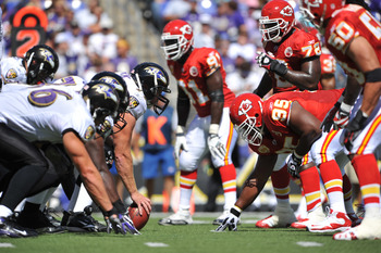 BALTIMORE - SEPTEMBER 13:  Matt Birk #77 of the Baltimore Ravens snaps the ball against the Kansas City Chiefs at M&T Bank Stadium on September 13, 2009 in Baltimore, Maryland. The Ravens defeated the Chiefs 38-24. (Photo by Larry French/Getty Images)