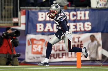 FOXBORO, MA - DECEMBER 06:  Devin McCourty #32 of the New England Patriots celebrates after he intercepted a pass against the New York Jets at Gillette Stadium on December 6, 2010 in Foxboro, Massachusetts.  (Photo by Elsa/Getty Images)