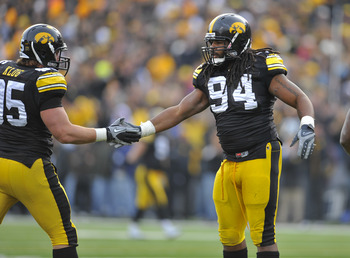 IOWA CITY, IA - NOVEMBER 20:  Defensive linemen Adrian Clayborn #94 and Karly Klug #95 of the University of Iowa Hawkeyes celebrate a quarterback sack against the Ohio State Buckeyes during the first half of play at Kinnick Stadium on November 20, 2010 in