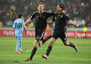 PORT ELIZABETH, SOUTH AFRICA - JULY 10:  Sami Khedira of Germany celebrates scoring his team's third goal with Per Mertesacker during the 2010 FIFA World Cup South Africa Third Place Play-off match between Uruguay and Germany at The Nelson Mandela Bay Sta
