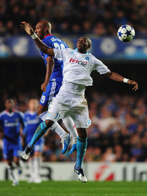 LONDON, ENGLAND - SEPTEMBER 28:  Nicolas Anelka of Chelsea challenges Stephane Mbia of Marseille during the UEFA Champions League Group F match between Chelsea and Marseille at Stamford Bridge on September 28, 2010 in London, England.  (Photo by Mike Hewi