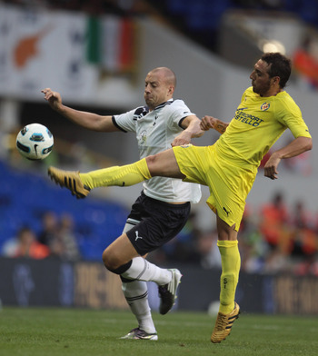 LONDON, ENGLAND - JULY 29: Santi Cazorla of Villarreal (R) tackles Alan Hutton of Tottenham Hotspur during a Pre-Season Friendly between Tottenham Hotspur and  Villarreal at White Hart Lane on July 29, 2010 in London, England.  (Photo by Phil Cole/Getty I