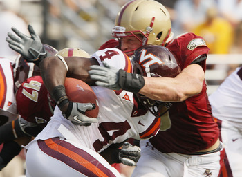 CHESTNUT HILL, MA - SEPTEMBER 25:  Alex Albright #98 of the Boston College Eagles tackles David Wilson #3 of the Virginia Tech Hokies on September 25, 2010 at Alumni Stadium in Chestnut Hill, Massachusetts. Virginia Tech defeated Boston College 19-0.  (Ph