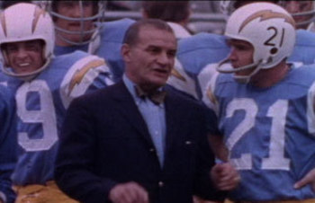 Sid Giman, with John Hadl and the great Lance Alworth partially obscured to his right.