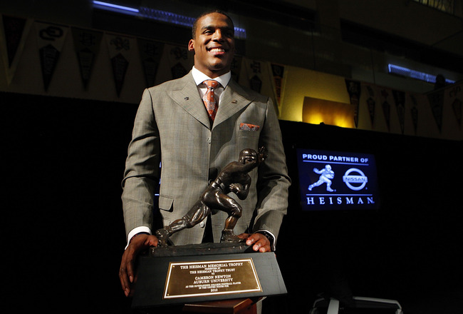 NEW YORK - DECEMBER 11:  Cam Newton, quarterback of the Auburn University Tigers, poses with the 2010 Heisman Memorial Trophy Award on December 11, 2010 in New York City.  (Photo by Jeff Zelevansky/Getty Images)