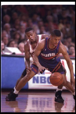 16 Jun 1993: Guard Kevin Johnson of the Phoenix Suns moves the ball during a game against the Chicago Bulls at the America West Arena in Phoenix, Arizona.