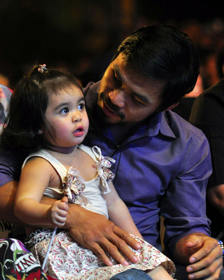 MANILA, PHILIPPINES - NOVEMBER 20:  Boxer and congressman, Manny Pacquiao attends his concert in Manila with wife Jinky and youngest daughter Qeen Elizabeth following his win of the WBC super welterweight crown against Mexican Antonio Margarito on Novembe