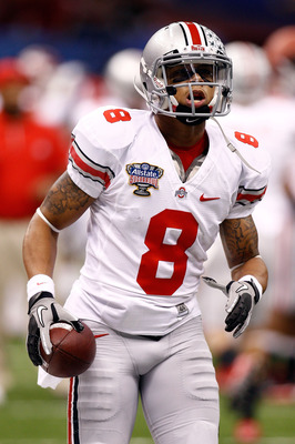 NEW ORLEANS, LA - JANUARY 04:  DeVier Posey #8 of the Ohio State Buckeyes looks on before taking on the Arkansas Razorbacks in the Allstate Sugar Bowl at the Louisiana Superdome on January 4, 2011 in New Orleans, Louisiana.  (Photo by Chris Graythen/Getty