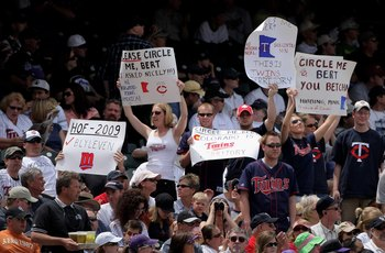 DENVER - MAY 18:  Minnesota Twins fans use signs to encourage television commentator Bert Blyleven to circle them on the telestrator as the Twins face the Colorado Rockies during Interleague MLB action at Coors Field on May 18, 2008 in Denver, Colorado. T