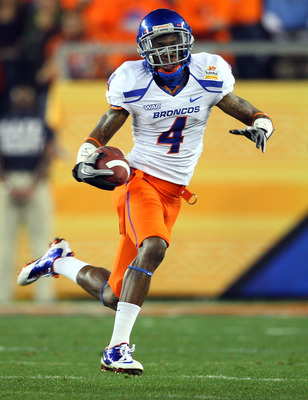 GLENDALE, AZ - JANUARY 04:  Titus Young #4 of the Boise State Broncos runs after a catch against the TCU Horned Frogs in the first half during the Tostitos Fiesta Bowl at the Universtity of Phoenix Stadium on January 4, 2010 in Glendale, Arizona.  (Photo