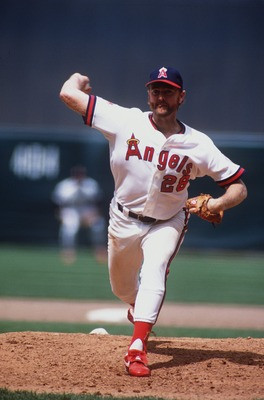 CALIFORNIA ANGELS PITCHER BERT BLYLEVEN WINDS UP TO PITCH DURING THE ANGELS GAME AT ANAHEIM STADIUM IN ANAHEIM, CALIFORNIA.