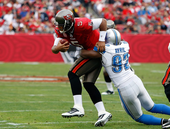 Defensive end Cliff Avril brings down Tampa Bay quarterback Josh Freeman in week 15.