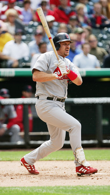 DENVER - JUNE 2:  Outfielder Larry Walker #33 of the St. Louis Cardinals bats against the Colorado Rockies during the game at Coors Field on June 2, 2005 in Denver, Colorado.  The Rockies defeated the Cardinals 8-7.  (Photo by Doug Pensinger/Getty Images)