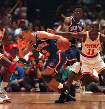 22 JUN 1994:  NEW YORK KNICK JOHN STARKS #3, DRIBBLES AROUND HOUSTON ROCKET HAKEEM OLAJUWON (LEFT) AS ROCKET VERNON MAXWELL PURSUES DURING THE SECOND QUARTER OF GAME 7 IN THE NBA CHAMPIONSHIP AT THE SUMMIT IN HOUSTON. Mandatory Credit: Allsport/ALLSPORT