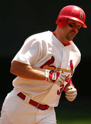 ST. LOUIS - MAY 7:  Larry Walker #33 of the St. Louis Cardinals rounds third base after he hit a solo home run in the first inning against the San Diego Padres on May 7, 2005 at Busch Stadium in St. Louis, Missouri.  (Photo by Elsa/Getty Images)
