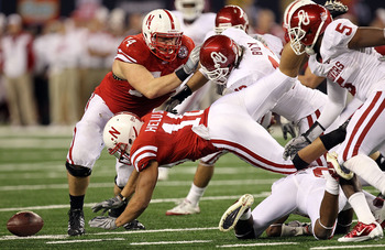 ARLINGTON, TX - DECEMBER 04:  Running back Roy Helu Jr. #10 of the Nebraska Cornhuskers fumbles the ball against the Oklahoma Sooners during the Big 12 Championship at Cowboys Stadium on December 4, 2010 in Arlington, Texas.  (Photo by Ronald Martinez/Get