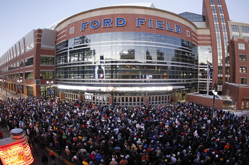 DETROIT, MI - DECEMBER 13: Football fans line up at Ford Field to enter the game between the New York Giants and the Minnesota Vikings on December 13, 2010 in Detroit, Michigan. (Photo by Leon Halip/Getty Images)