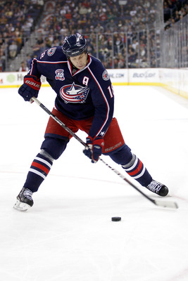 COLUMBUS, OH - DECEMBER 21:  R.J. Umberger #18 of the Columbus Blue Jackets shoots the puck during a game against the Calgary Flames on December 21, 2010 at Nationwide Arena in Columbus, Ohio.  (Photo by John Grieshop/Getty Images)
