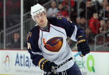 NEWARK, NJ - DECEMBER 31:  Bryan Little #10 of the Atlanta Thrashers looks on against the New Jersey Devils at the Prudential Center on December 31, 2010 in Newark, New Jersey. The Devils defeated the Thrashers 3-1.  (Photo by Jim McIsaac/Getty Images)